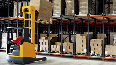 Forklift at work in warehouse